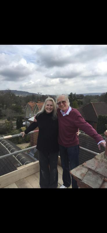 Image 2 - happy customer's enjoying the view from the scaffolding following chimney restoration in Cranleigh Surrey