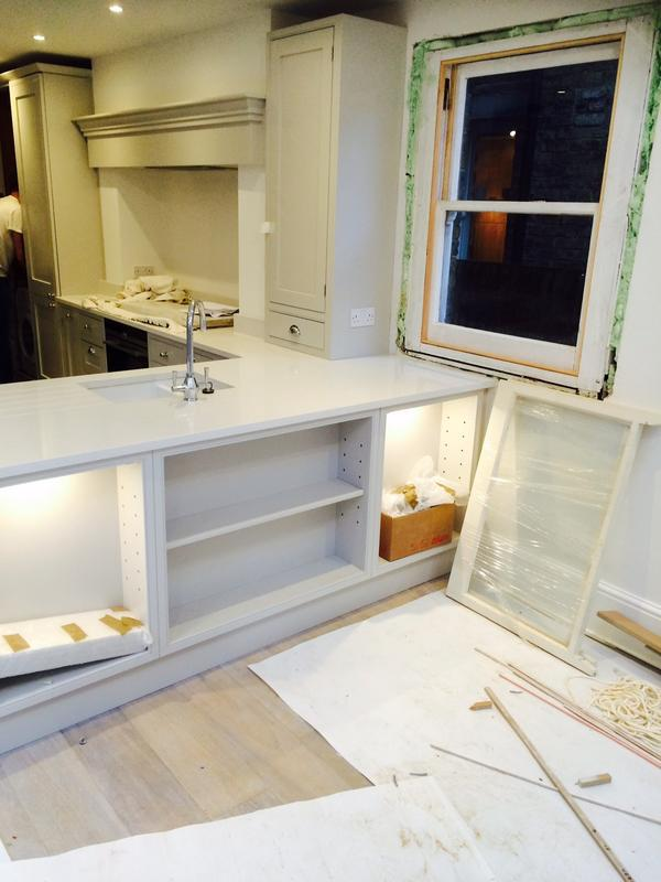 Image 41 - Bespoke English kitchen stage 9 (marble installed over units, lights installed to the front glass doors units).