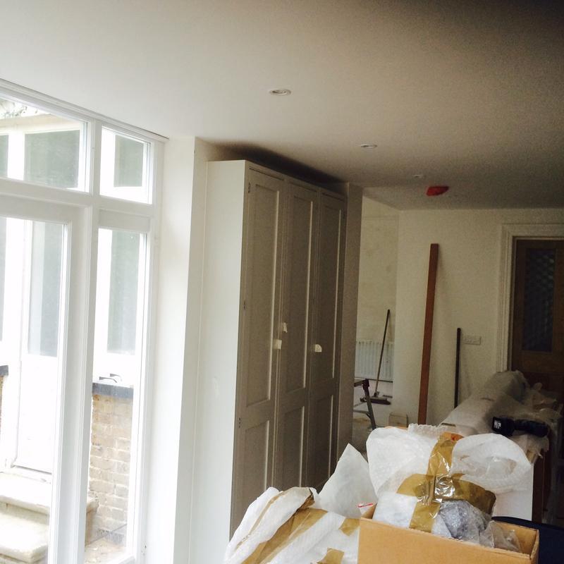 Image 34 - Bespoke English kitchen stage 2 (setting up tall units).