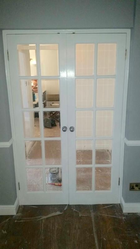Image 25 - Double doors installed into opening. Fitted and painted by Ollie Diggins