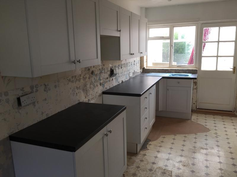Image 15 - This kitchen was for a rental property, white shaker doors and black worktop