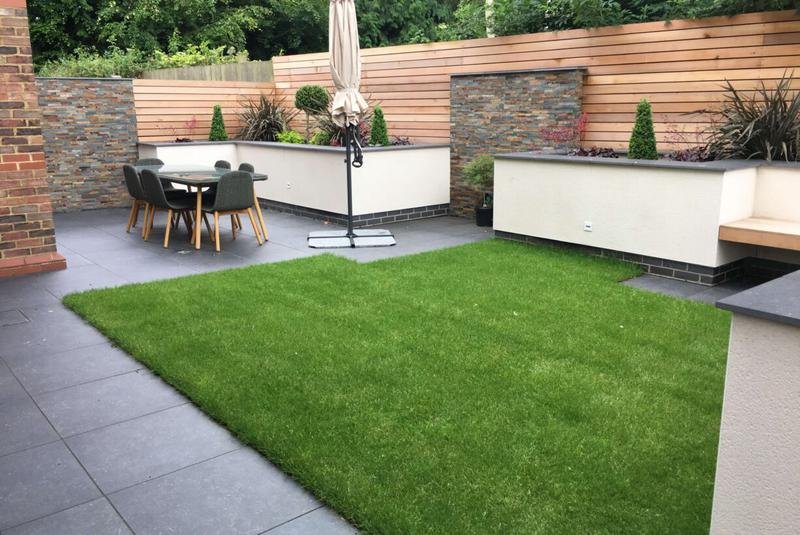 Image 4 - Artificial grass, concrete block planters with smooth render finish.