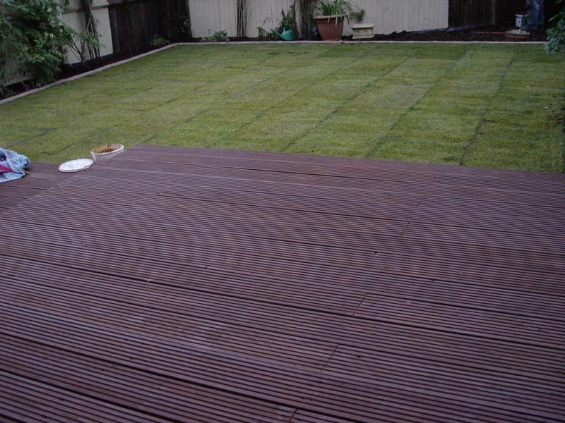 Image 15 - Fitting decking and turf remaining area