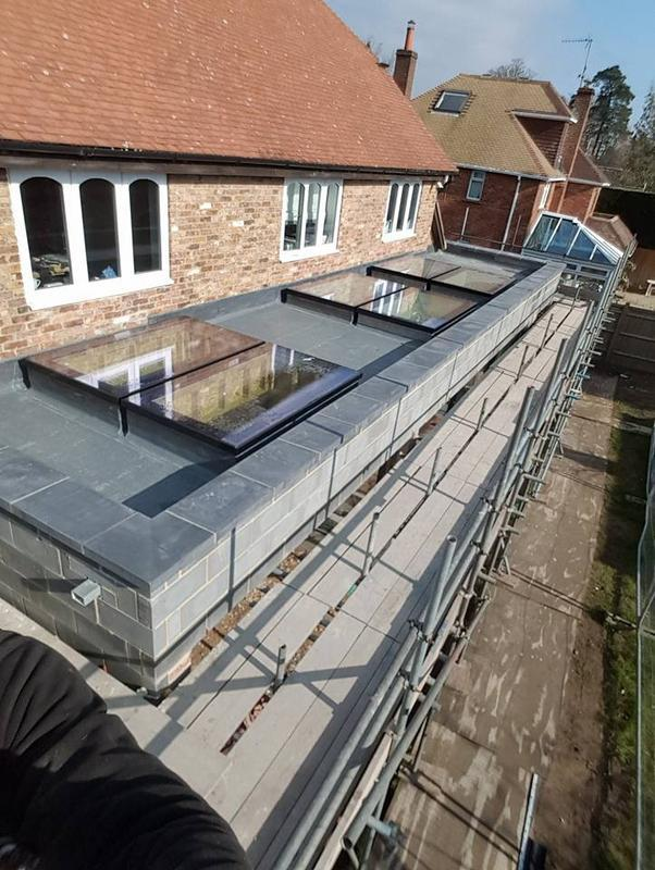 Image 3 - The after photo of the same large GRP (Glass-reinforced plastic) roof.