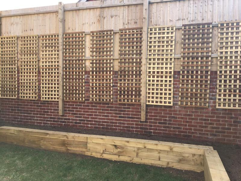 Image 73 - New trellis panels with raised sleeper beds, Charminster