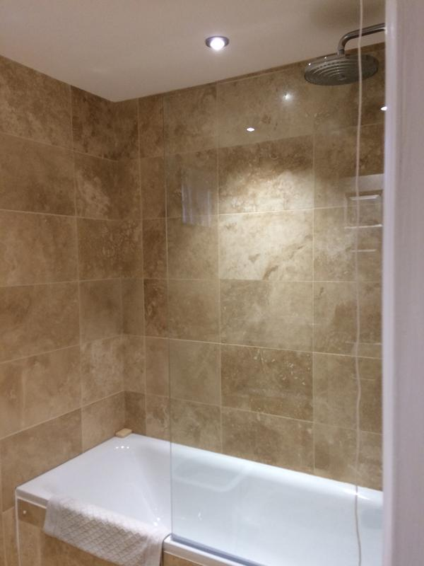 Image 40 - Bathroom renovation using travertine tiles by DKM Developments Ltd, builders, Great Dunmow, Essex.