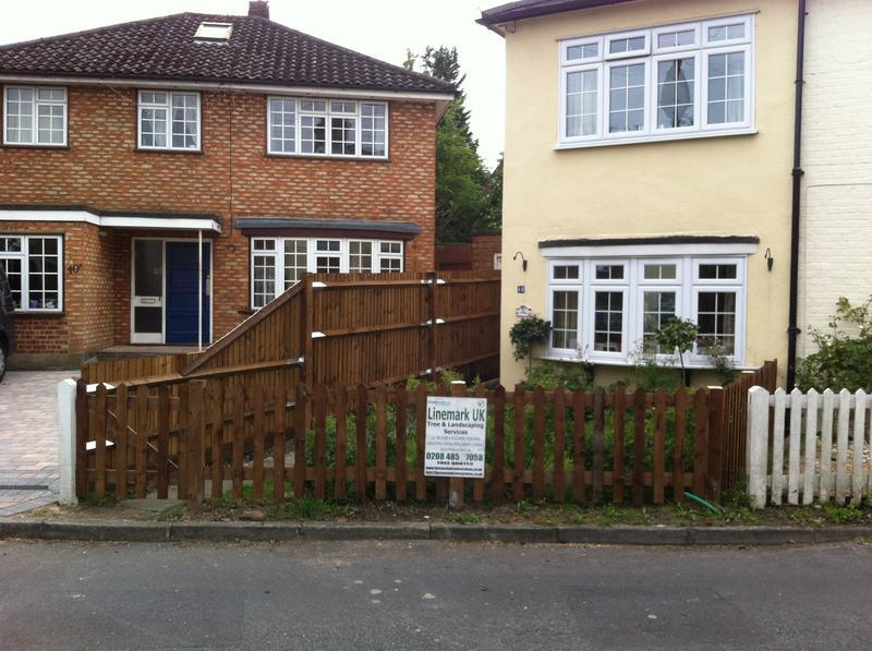 Image 106 - Picket fence and feather board fence with slope down top