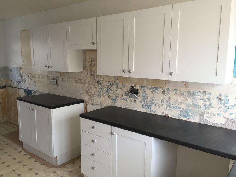 Image 16 - This kitchen was for a rental property, white shaker doors and black worktop