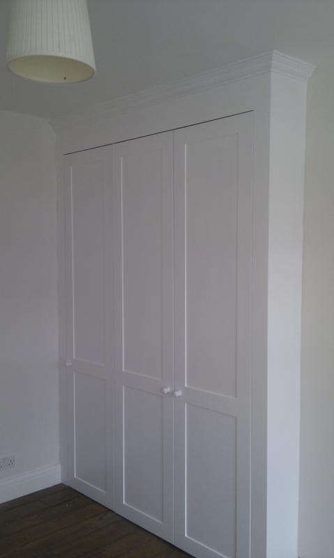 Image 18 - Large alcove fitted wardrobe.