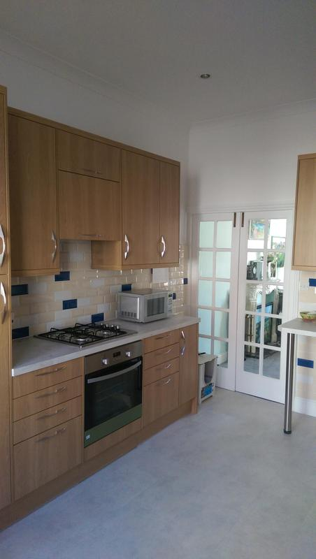 Image 17 - Painting of a kitchen that was newly fitted in Fulham. Client wanted a white finish for the walls and woodwork. Doors were painted too.