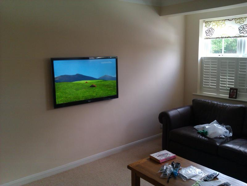 Image 14 - Wall mount TV and hide cabling through into garage of bungalow