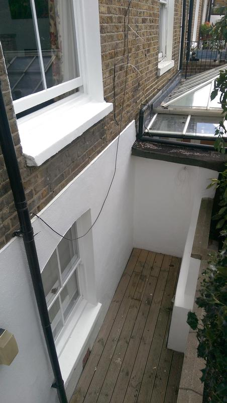 Image 52 - Exterior repair and decoration to a sub level flat in Fulham. Walls, windows, sills all repaired and painted. Decking laid at the back once painting was finished.