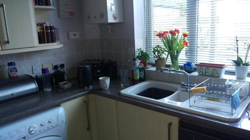 Image 2 - The client asked for the sink, work top and flooring to be changed, this is a photo of the kitchen before works have started