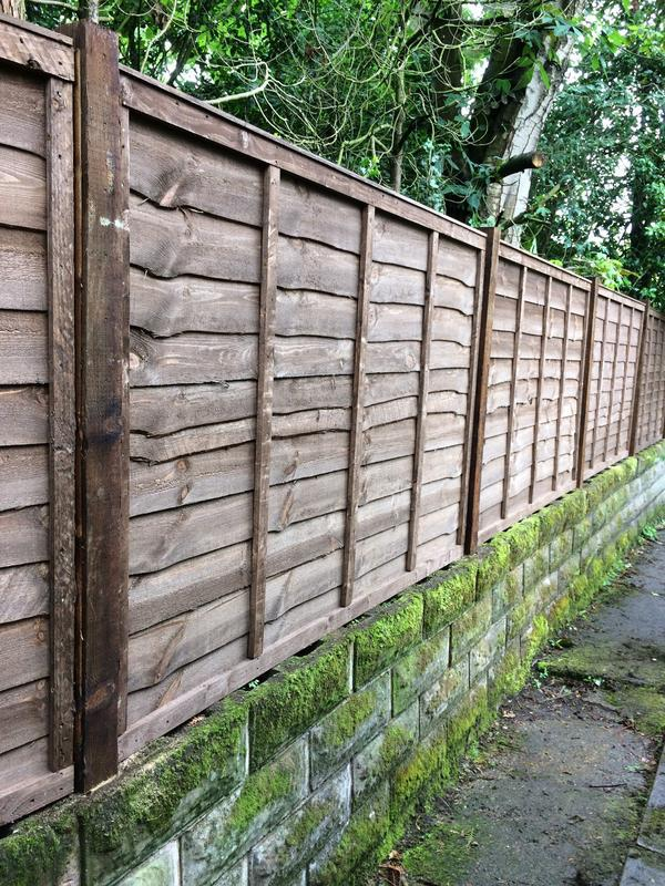 Image 9 - Wooden posts and waney panels to fit existing wall