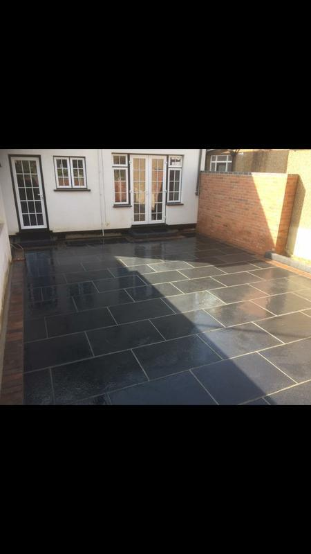 Image 50 - Black granite edged with block paver