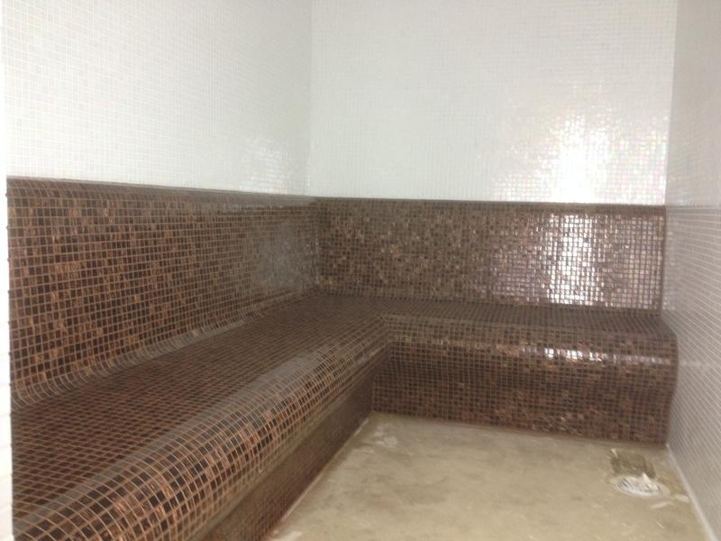 Image 105 - Mosaic walls and bench in Steamroom