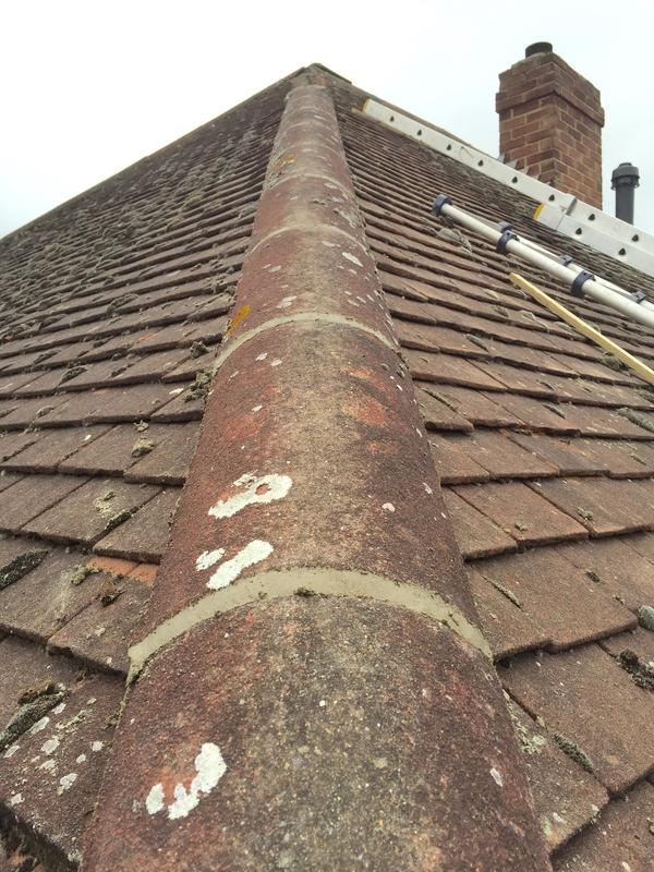 Image 13 - Re bedding and pointing hip tiles