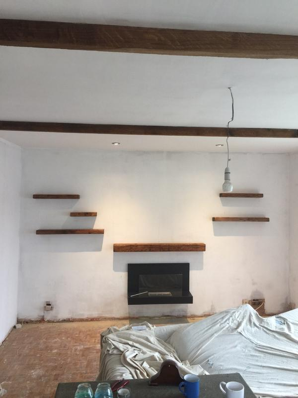 Image 11 - Thetford living room refurb mist coated with floating oak shelves and floating fire place.