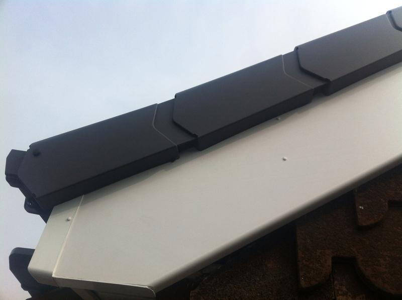 Image 1 - White Upvc with grey dry verge system