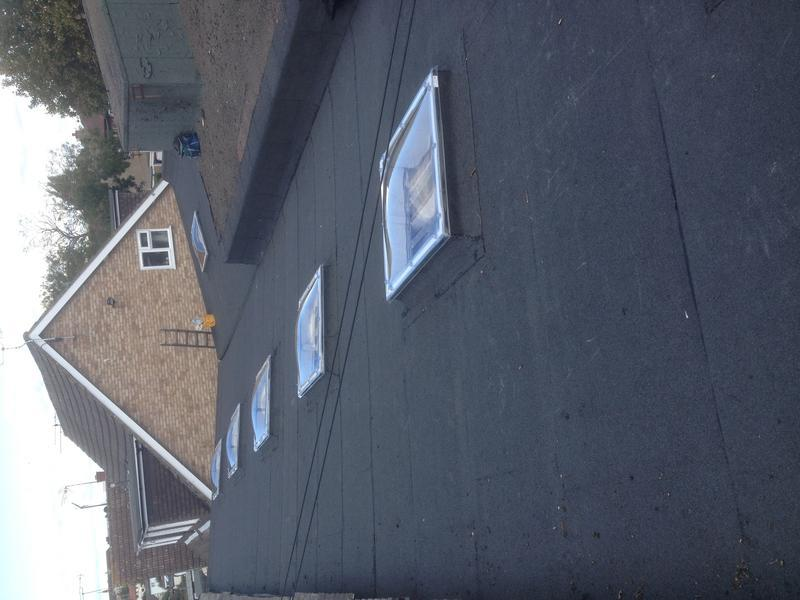 Image 1 - New felt roof and roof lights London rd Leigh on sea