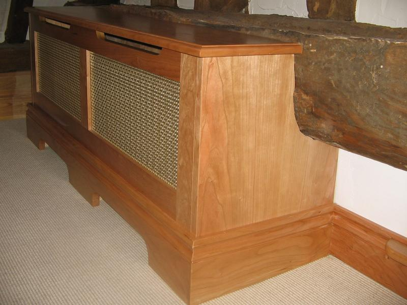 Image 49 - Bespoke radiator scribed around oak beam.