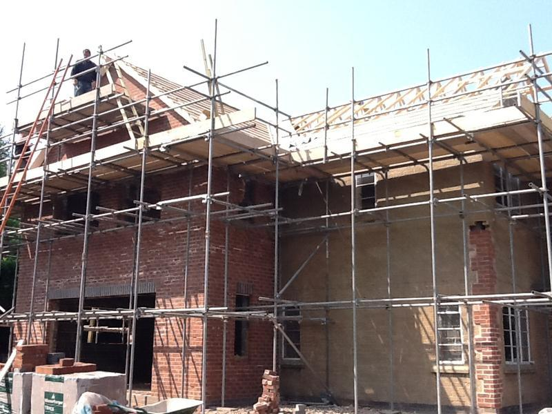 Image 29 - The intricate gable ends are built and the roof tiling starts Jul 2012