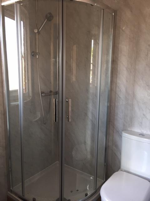 Image 5 - En-suite refitted all works including wall boards