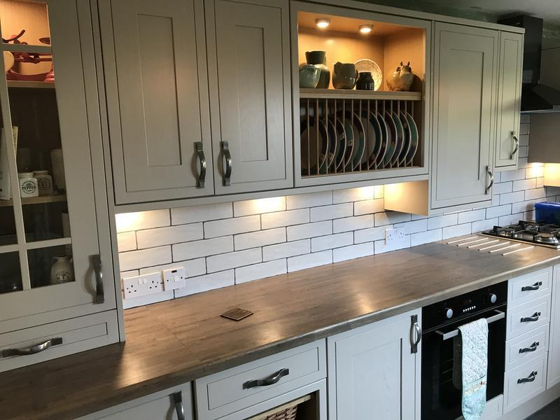 Image 1 - solid oak worktop shaker door and met tiles with an open plate rack and under lights all work completed by Joinery4u including flooring