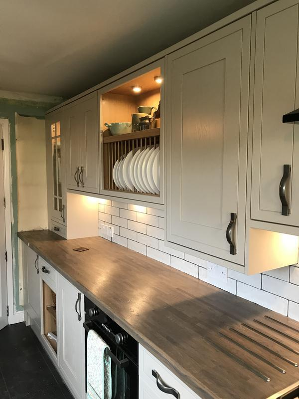 Image 2 - a different view solid oak worktop shaker door and met tiles with an open plate rack and under lights all work completed by Joinery4u including flooring