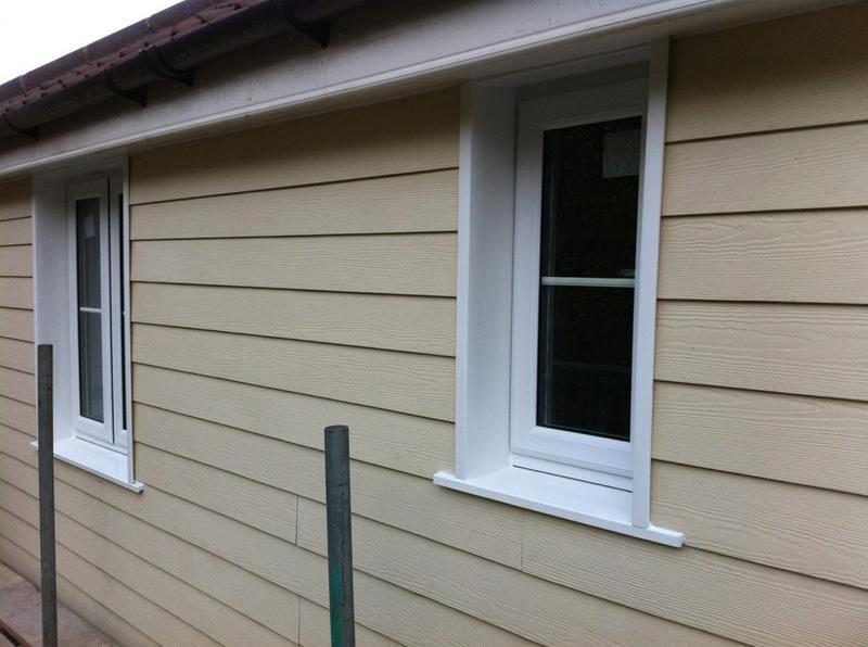 Image 2 - White upvc windows with cream cladding
