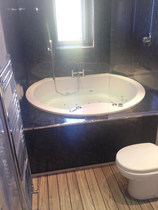 Image 39 - Large Jacuzzi Bath Inset Into Bespoke Framework