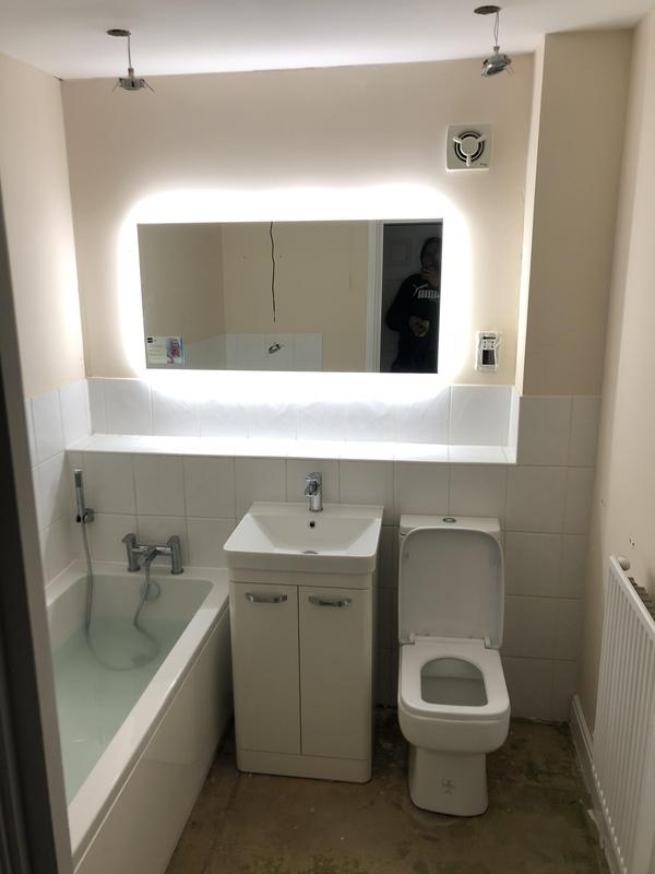 Image 5 - This bathroom was done in Welham Green for a landlord. A simple bathroom design with a back lit LED mirror to add detail and make the room look bigger.