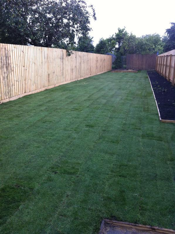 Image 21 - New featheredge fence, turf and flower beds