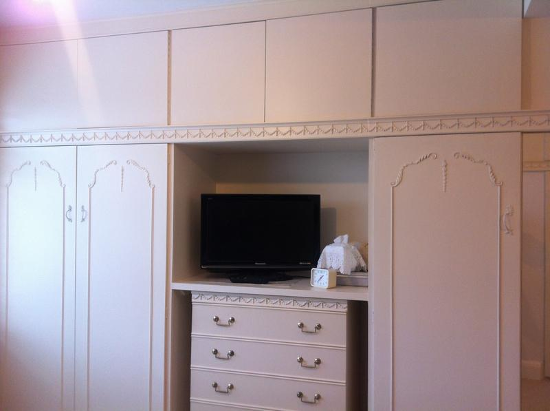 Image 19 - built wardrobes left and top left and middle to match right hand side that