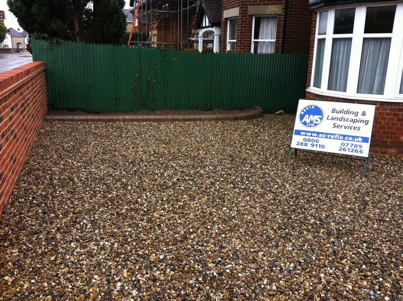 Image 25 - New gravel driveway with a new wall and edged flowerbed