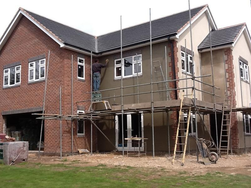 Image 37 - Outside windows are fitted scaffolding removed and rendering done Aug 2012