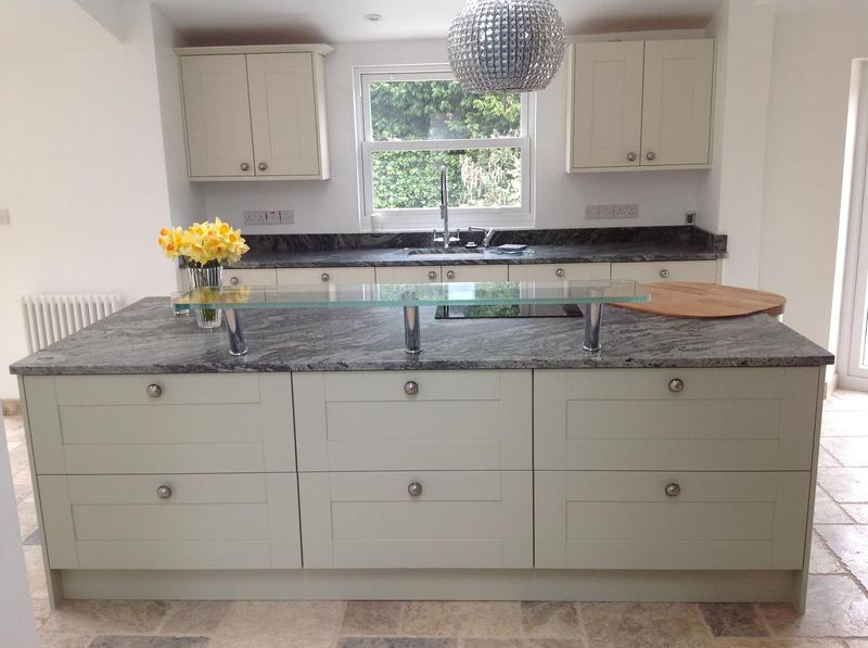 Image 38 - Shaker kitchen installed in new extension with granite worktops and high level glass breakfast bar.