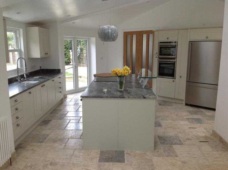Image 39 - Shaker kitchen installed in new extension with granite worktops and high level glass breakfast bar.