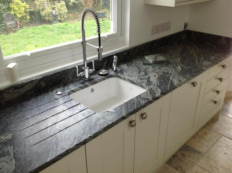 Image 47 - Shaker kitchen installed in new extension with granite worktops and high level glass breakfast bar.