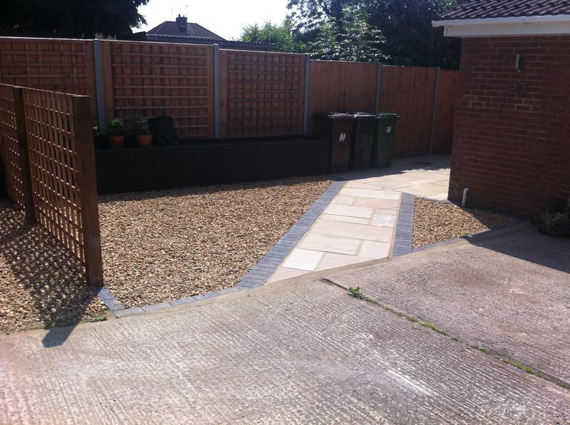 Image 7 - front garden path with shingle and new fencing
