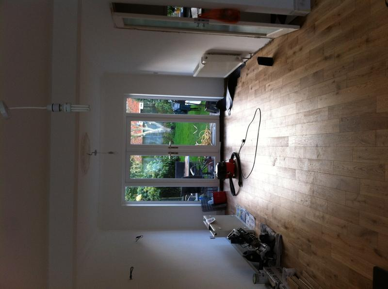 Image 38 - Open plan loung dinning room plastering, painting and apply new engennering wood flooring