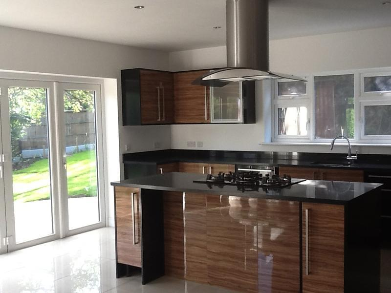 Image 9 - The modern high gloss kitchen is fitted Aug 2012