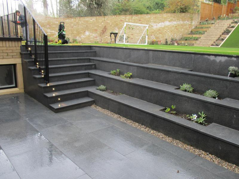 Image 1 - Granite patio with steps, flowerbed and metal railing..