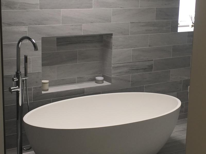Image 21 - A well designed free standing tap and oval bath in Totteridge with recesses used for storage and bathroom decoration.
