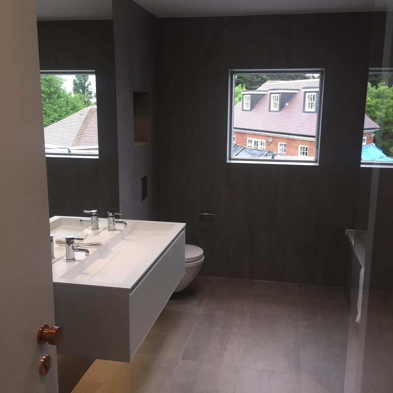 Image 17 - This luxury bathroom is fitted with a wall hung basin and wall recesses for extra storage.