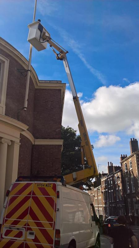 Image 3 - Using the Cherry Picker to paint exterior offices