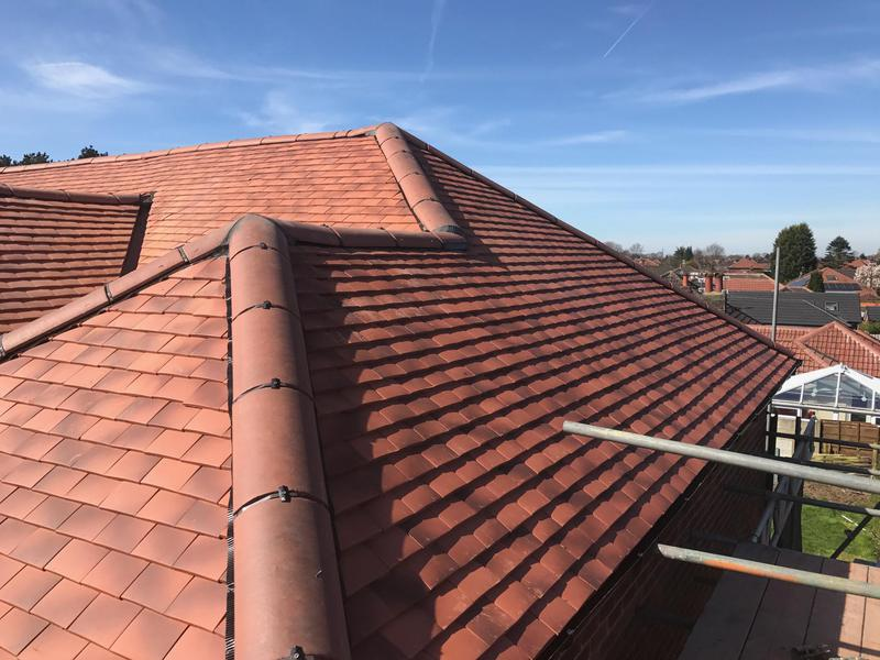 Image 5 - New roof structure over a flat roof and a total re roof