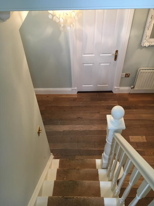 Image 7 - Woodwork on the stairs, banisters and spindles painted in a Farrow & Ball undercoat, with a (James White 2005) water-based eggshell. Farrow & Ball powder green emulsion (Estate) on the walls.