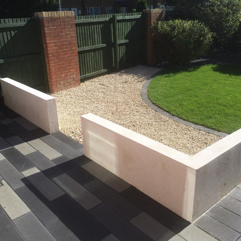 Image 23 - White render walling, gravel area, turf and patio