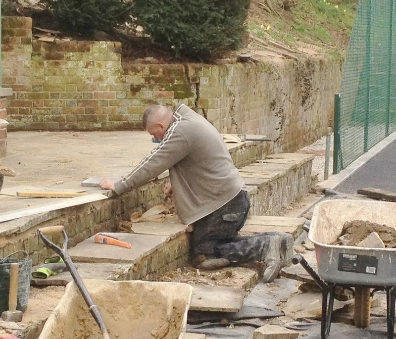 Image 25 - relaying some old lime stone slabs round a tennis court